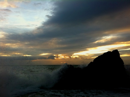 Waves crashing, sun rising